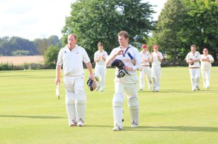 Dom and Potts leave the field after securing another big win for the Coleshill 1st XI